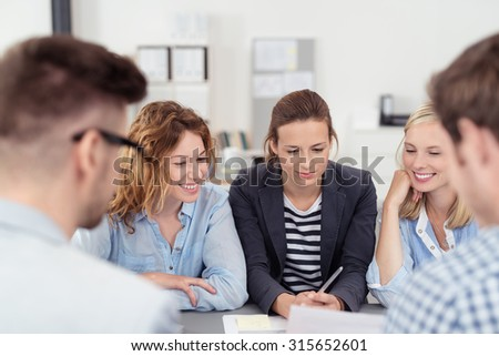 Five Young Office People Brainstorming for Ideas at the Table Inside the Boardroom. - stock photo