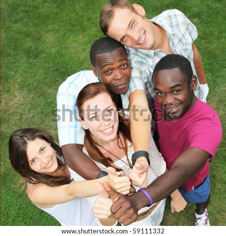 Five young people from different nations and laughing keep up the thumb - stock photo
