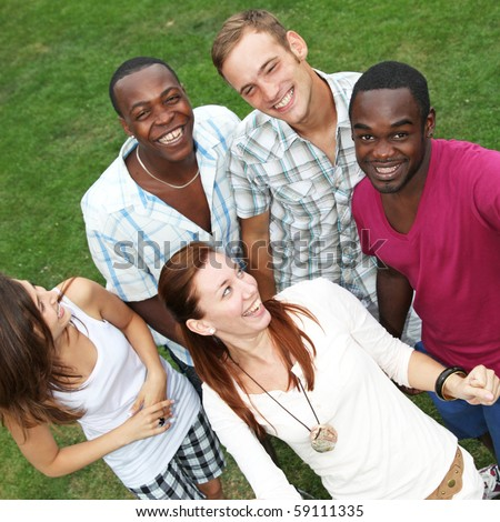 Five young people from different nations - Top View - stock photo
