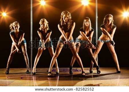 Five young women show on scene. - stock photo
