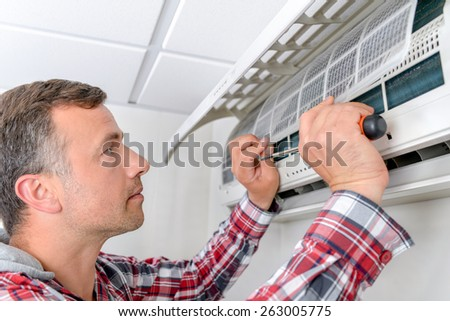 Fix this air conditioning - stock photo