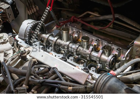 Fixing car engine using local method and simply tools found in local part of Thailand - stock photo
