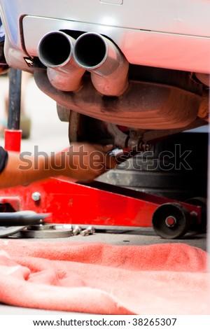 Fixing car wheel - stock photo