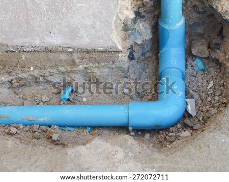 Fixing leaked water pipe on the wall - stock photo