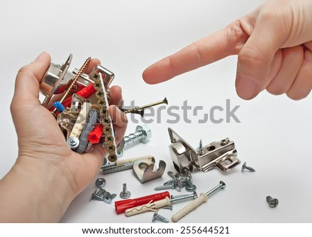 Fixing material in hands on white background - stock photo