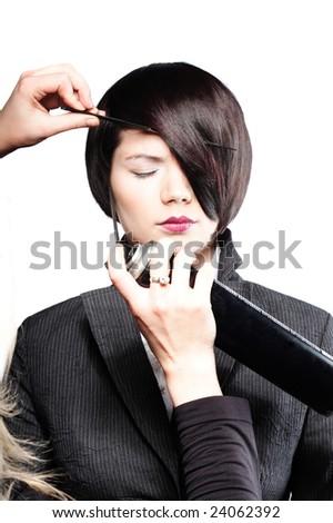 Fixing model's hair - stock photo