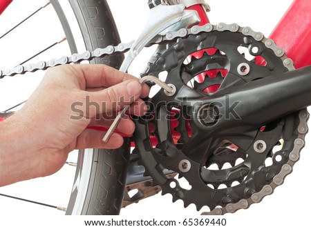 fixing the chainring on a mountain bike - stock photo