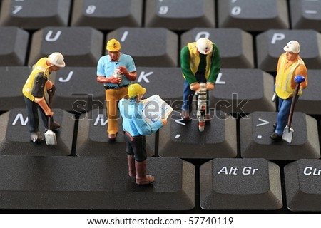 Fixing the Computer - stock photo