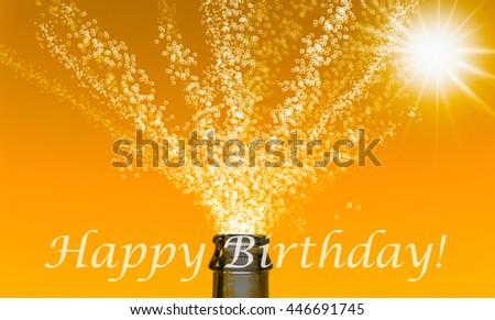 fizzing splash with Happy Birthday slogan on orange background - stock photo