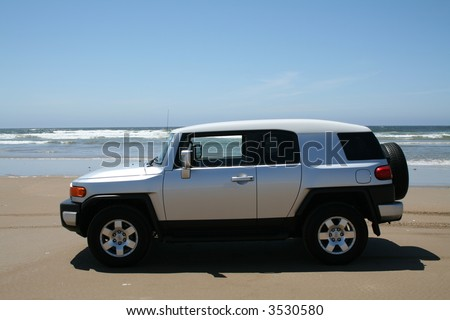 FJ Cruiser on Beach in California - stock photo