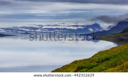 Fjord at Iceland with in the distance Vigur island