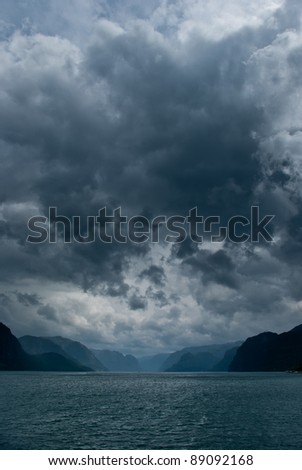 fjord with dark clouds - stock photo