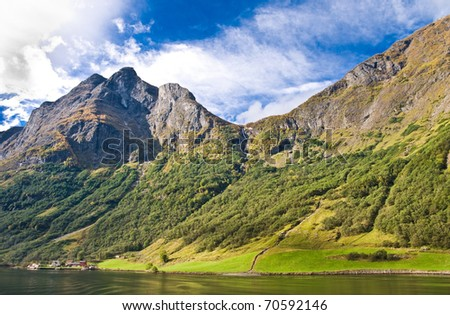 Fjords in Norway and Scandinavian nature: mountains, trees, rivers - stock photo