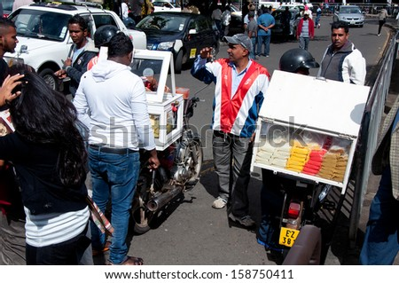 FLACQ; MAURITIUS - JUNE 23: Mobile street seller selling sweets on JUNE 23, 2013 in FLAQC, MAURITIUS.