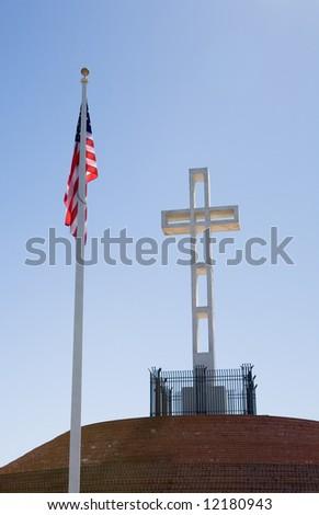 Flag and cross dedicated to veterans of American wars on top of Mount Soledad in La Jolla California - stock photo