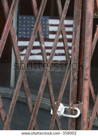 Flag and padlock. Metaphor for homeland security or open borders? - stock photo