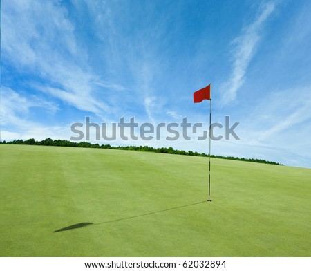 Flag and the golf field - stock photo