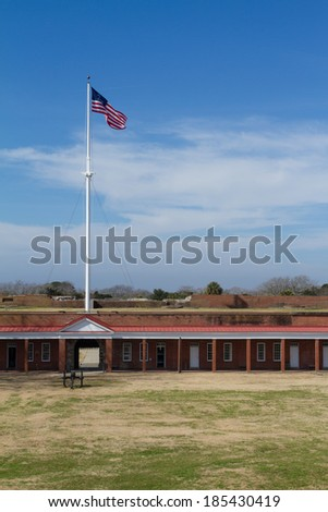 Flag at Fort Pulaski next to Tybee island - stock photo