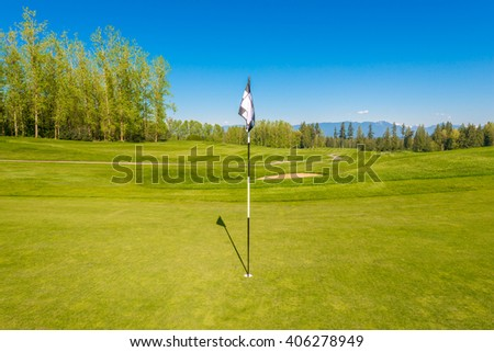 Flag at the beautiful golf course.