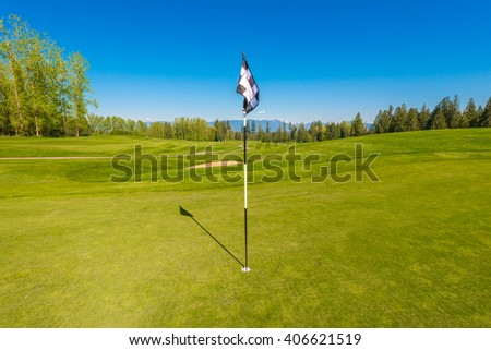 Flag at the gorgeous golf course. - stock photo