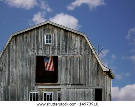 flag flying in hayloft - stock photo