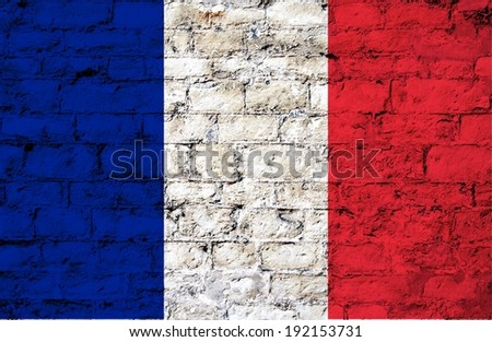 flag from France  painted on a stone wall ; participant at the soccer games in Brazil  - stock photo