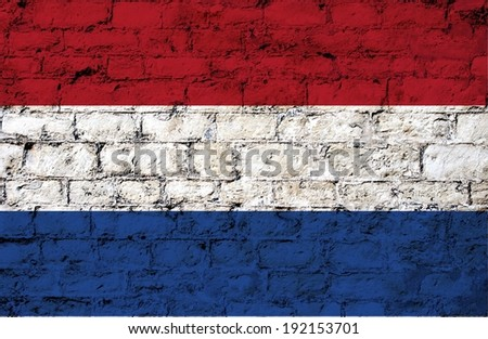flag from Netherlands  painted on a stone wall ; participant at the soccer games in Brazil  - stock photo