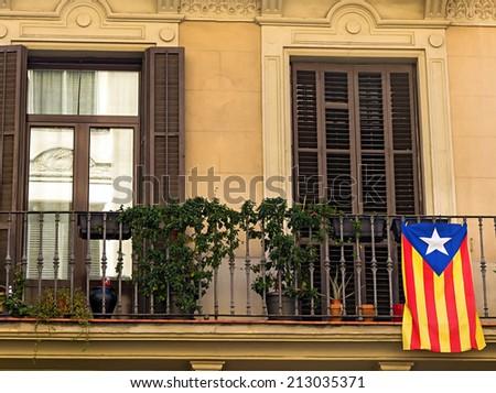 flag in balcony Barcelona. Catalonia - stock photo