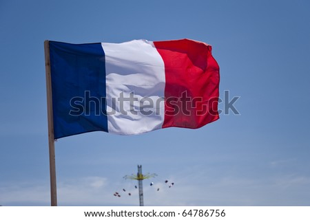 flag in front of blue sky - stock photo