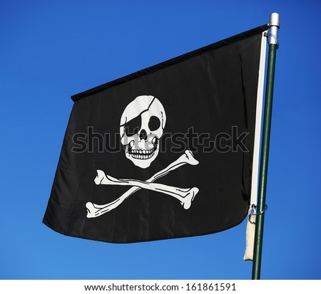 Flag of a Pirate skull and crossbones - stock photo