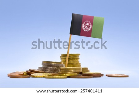 Flag of Afghanistan in a mixed stack of european coins and a blue background.(series) - stock photo