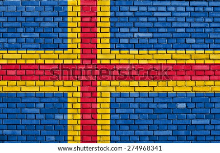 flag of Aland painted on brick wall