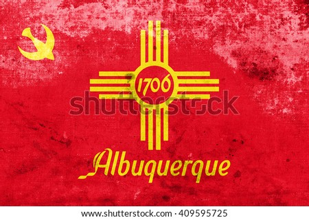 Flag of Albuquerque, New Mexico, with a vintage and old look - stock photo