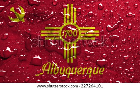 flag of Albuquerque with rain drops - stock photo