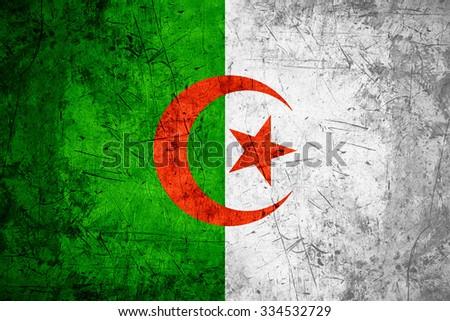 flag of Algeria or Algerian banner on rough pattern metal background - stock photo