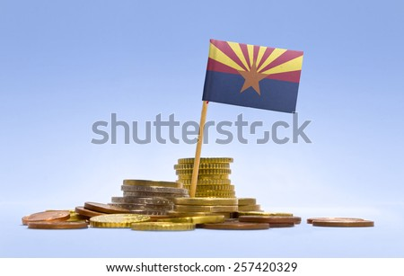 Flag of Arizona in a stack of coins.(series) - stock photo