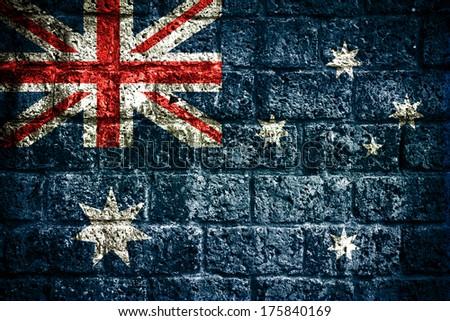 Flag of Australia painted onto a grunge brick wall  - stock photo
