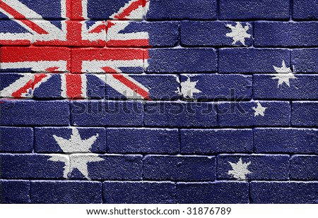 Flag of Australia painted onto a grunge brick wall - stock photo