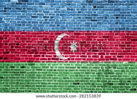Flag of Azerbaijan painted on brick wall, background texture - stock photo