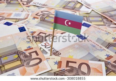 Flag of Azerbaijan sticking in european banknotes.(series) - stock photo