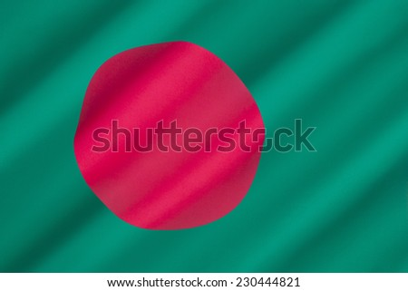 Flag of Bangladesh - The red disc, representing the sun, is off set from center on a green background representing the lush green land of Bangladesh. Adopted on 17th January 1972. - stock photo