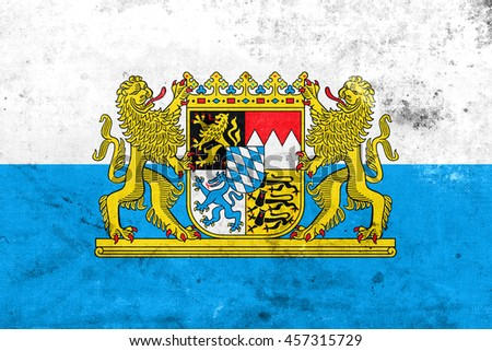 Flag of Bavaria with Coat of Arms, Germany, with a vintage and old look - stock photo