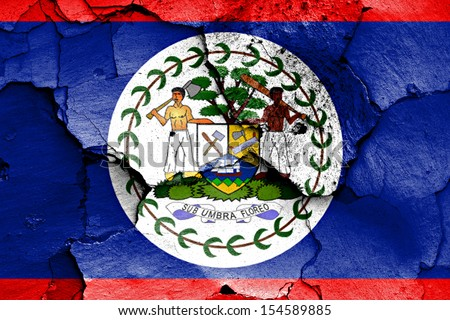 flag of Belize painted on cracked wall