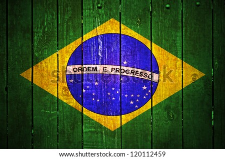 Flag of Brazil on wooden texture
