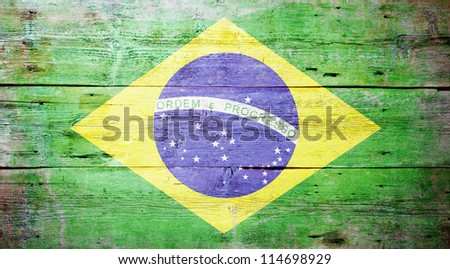 Flag of Brazil painted on grungy wood plank background - stock photo