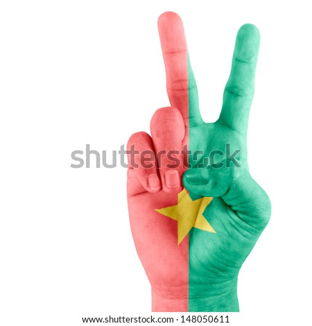 Flag of Burkina Faso on hand of victory gesturing with white background.  - stock photo