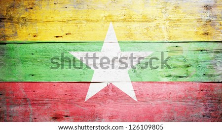 Flag of Burma painted on grungy wood plank background - stock photo