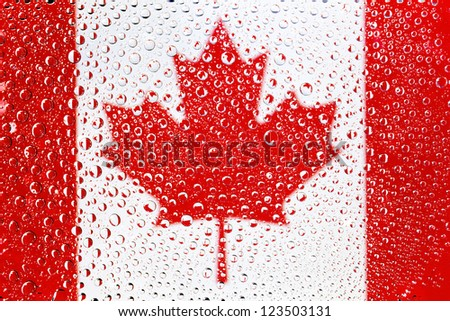 Flag of Canada. Canadian flag with rain droplets. - stock photo