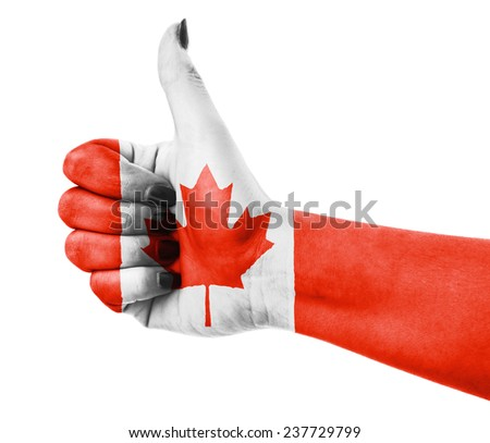 Flag of Canada over female's hand - stock photo