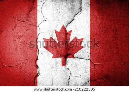 flag of Canada painted on cracked wall - stock photo